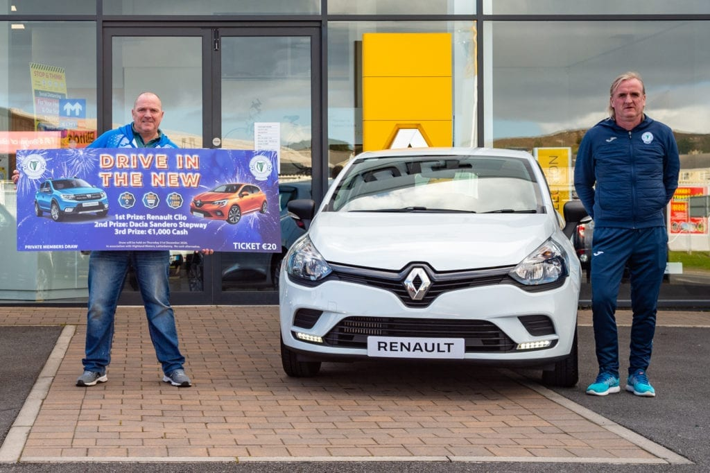 Ollie Horgan stands beside a Renault Clio for the Finn Harps Mega Car Draw