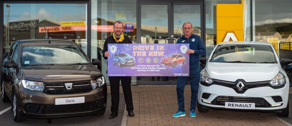 Ollie Horgan holds a giant ticket for the Finn Harps Mega Car Draw